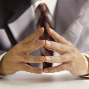 Businessman Clasping Hands